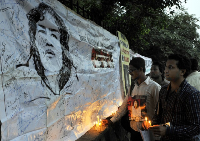 NEW DELHI, INDIA - NOVEMBER 4: The members of Save Sharmila Solidarity Campaign observed candle light vigil in solidarity with Remove AFSPA at Raj Ghat on November 4, 2013 in New Delhi, India. Manipuri civil rights activist Irom Sharmila Chanu also known as Iron Lady of Manipur is completing 13 years of her hunger-protest to repeal Armed Forces (Special Powers) Act, 1958 on November 5. (Photo by Sushil Kumar/Hindustan Times via Getty Images)
