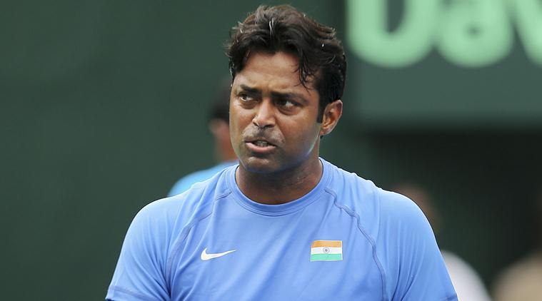 India's Leander Paes reacts after scoring a point during the Davis Cup World Group play-off doubles match against Czech Republic's Adam Pavlasek and Radek Stepanek in New Delhi, India, Saturday, Sept. 19, 2015. The Czech Republic defeated India 5-7, 2-6, 2-6. (AP Photo/Altaf Qadri)