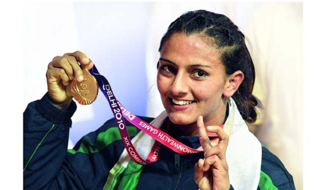 Geeta of India celebrates with her gold medel after defeating Emily Bensted of Australia (Red) in Wrestling on 55Kg catagory of CWG 2010 in New Delhi on Thusday,October 07,2010. Photograph......Priram Bandyopadhyay